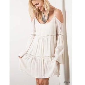 Umgee women's dress size s cream-like color